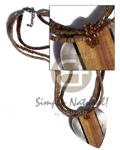 3 rows - 2-3mm coco heishe nat. white/brown and glass beads combination  60mmx55mm hammershell, wood grain, blacklip in laminated clear heart /  7mm thickness / 18in - Coco Necklace