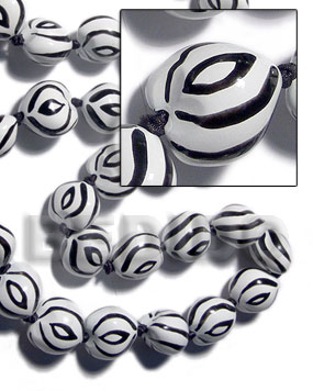 Kukui seeds in animal print Kukui Lumbang Nuts Beads