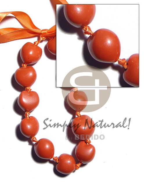 hand made Kukui nuts in pearlized orange Kukui Necklace