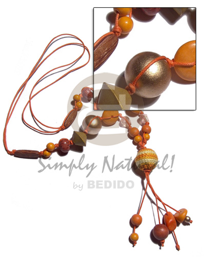 2 layers tassled wax cord  asstd. wood beads combination in orange tones and 20mm gold and wrapped round 20mm wood bead / 28in plus 3in tassles - Tassled Necklace