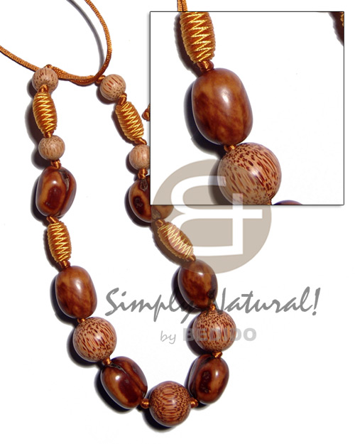 Capsule wrapped wood beads